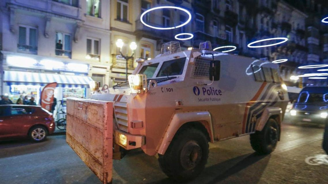 An armoured vehicle is seen while Belgian special forces patrol during a police raid in central Brussels, Belgium, December 20, 2015   Reuters