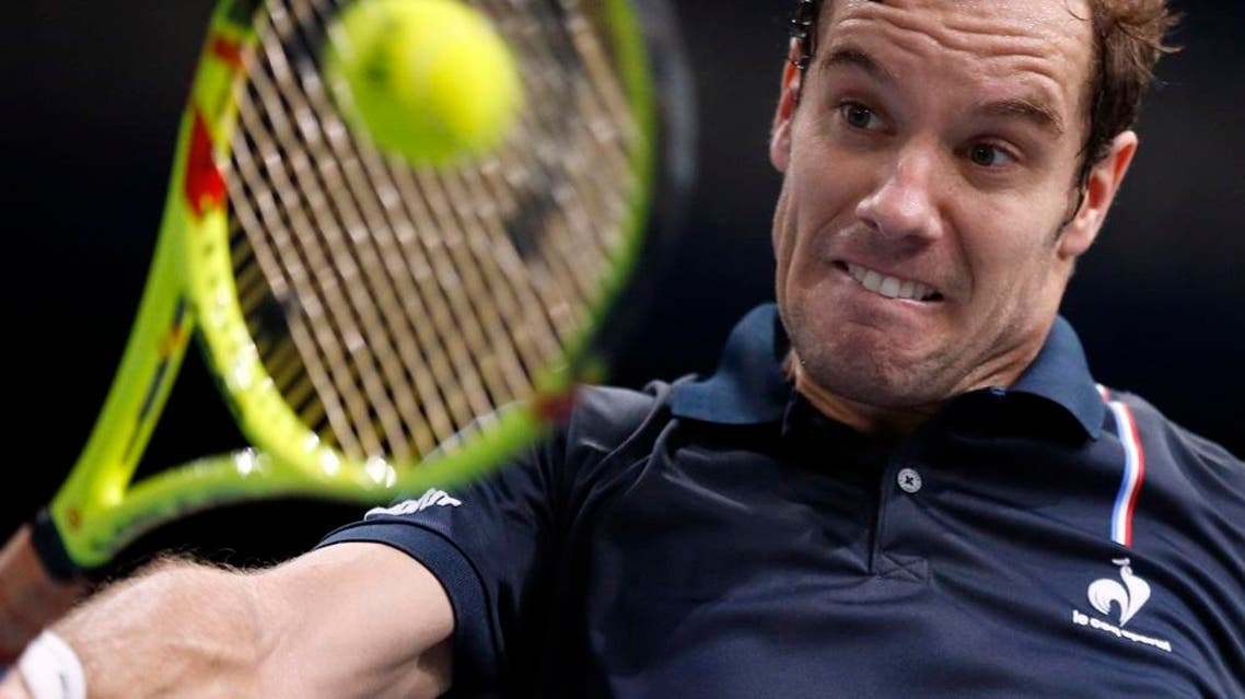 France's Richard Gasquet returns the ball to Leonardo Mayer of Argentina, during their second round match of the BNP Masters tennis tournament, at the Paris refurbished Bercy Arena, in Paris, France, Wednesday, Nov. 4, 2015 | AP