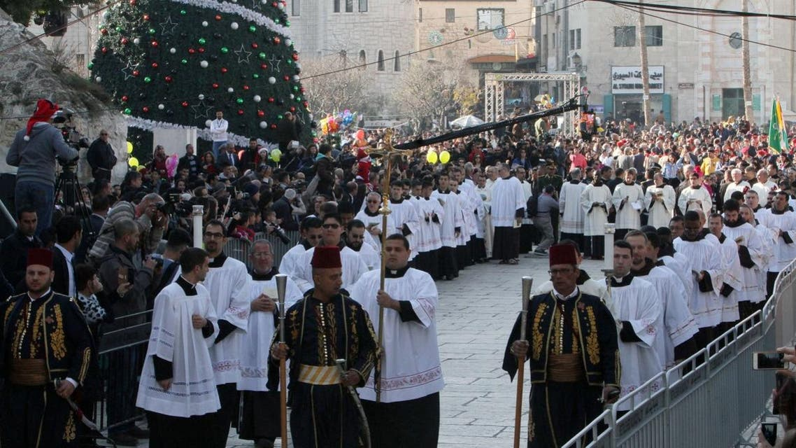 Clergymen march in Manger Square outside the Church of the Nativity as Christians gather for Christmas celebrations in the West Bank city of Bethlehem, on December 24, 2015. (Reuters)