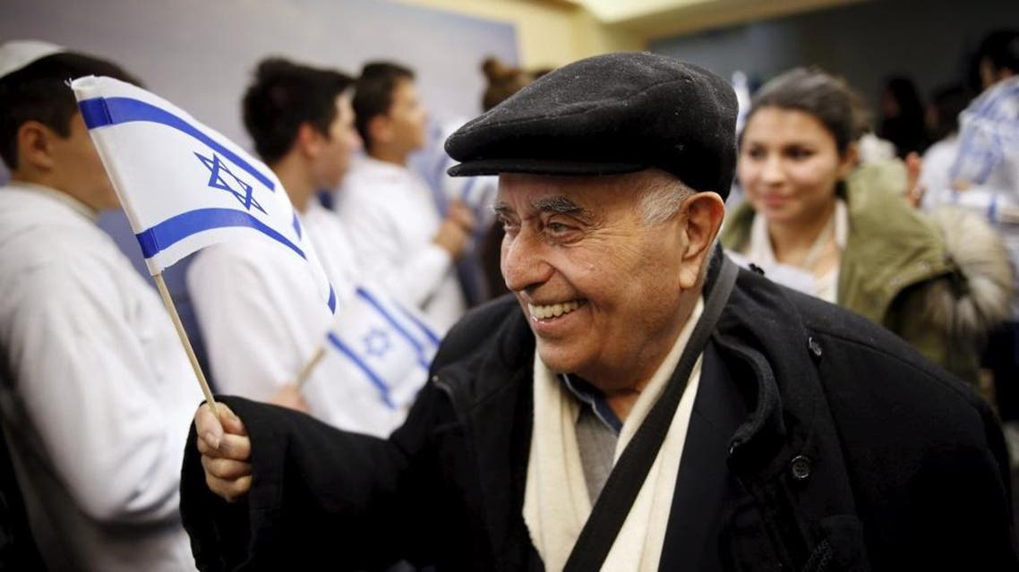 A Jewish immigrant from France arrives for a candle-lighting ceremony to mark the Jewish holiday of Hanukkah, upon landing at Ben Gurion International Airport near Tel Aviv, Israel December 8, 2015 | Reuters