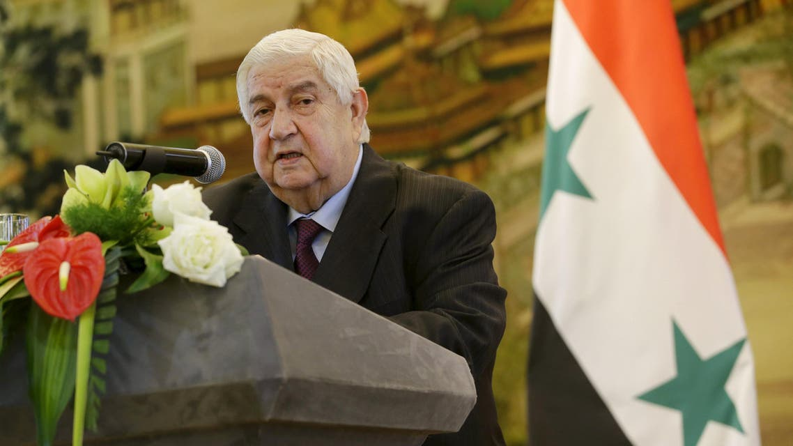 Syria's Foreign Minister Walid al-Moualem speaks during a joint news conference with China's Foreign Minister Wang Yi (not seen) after a meeting at the Ministry of Foreign Affairs in Beijing, China, December 24, 2015.