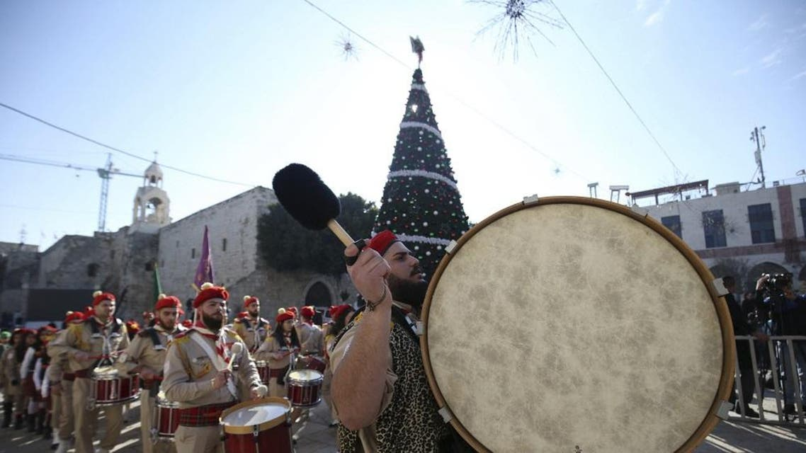 A Palestinian marching band parades during a Christmas procession at Manger Square in the West Bank town of Bethlehem December 24, 2015. (Reuters)