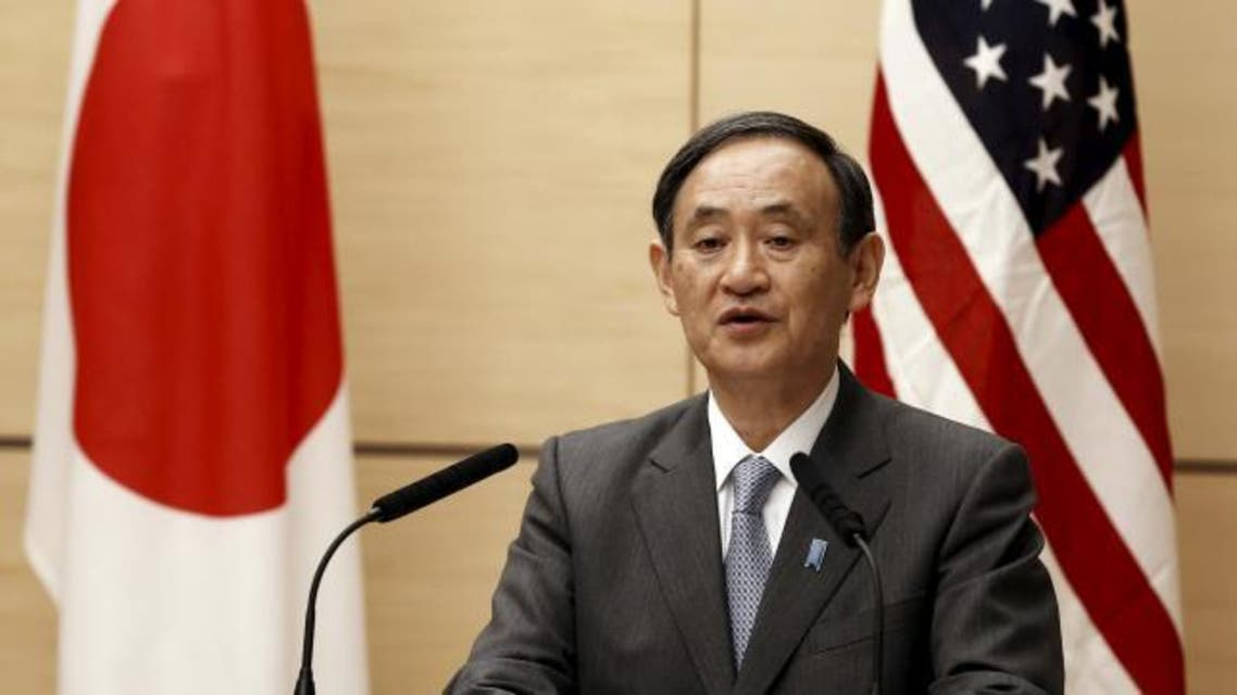 Japan's Chief Cabinet Secretary Yoshihide Suga speaks during a joint Japan-U.S. meadia briefing about the process of U.S. forces consolidation in Okinawa, at Tokyo December 4, 2015.