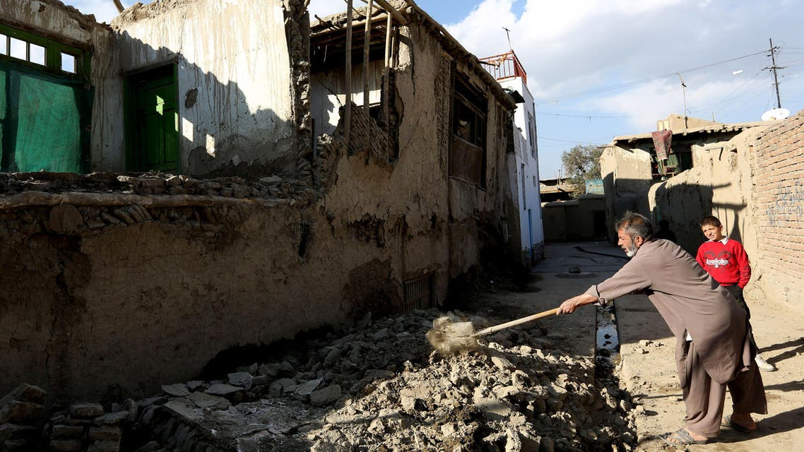 An Afghan man clears rubble from a damaged house following a strong earthquake, in Kabul, Afghanistan, Monday, Oct. 26, 2015. The U.S. Geological Survey said the epicenter of the 7.5-magnitude earthquake was in the Hindu Kush mountains, in the sparsely populated province of Badakhshan, which borders Pakistan, Tajikistan and China. It said the epicenter was 213 kilometers (130 miles) deep and 73 kilometers (45 miles) south of the provincial capital, Fayzabad. (AP Photo/Rahmat Gul)