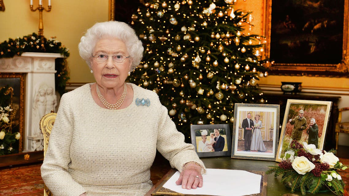 In this Dec. 10, 2015 photo, Britain's Queen Elizabeth II sits at a desk in the 18th Century Room in Buckingham Palace in London, after recording her Christmas Day broadcast to the Commonwealth, to be broadcast Friday, Dec. 25, 2015.
