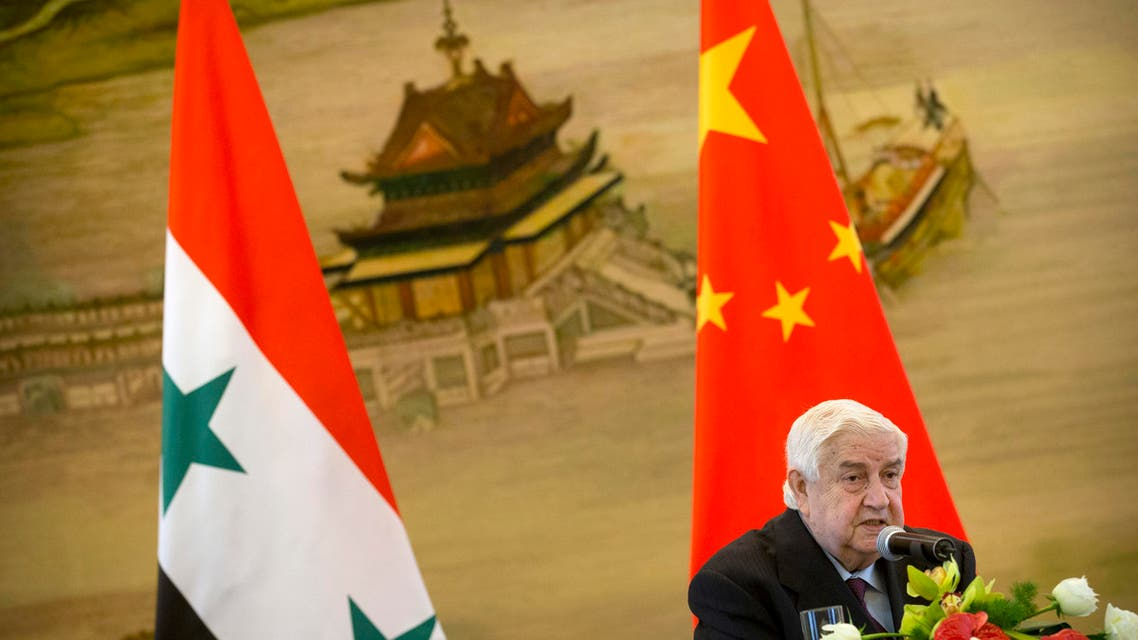 Syrian Foreign Minister Walid al-Moallem speaks during a press briefing with his Chinese counterpart Wang Yi at China's Ministry of Foreign Affairs in Beijing, Thursday, Dec. 24, 2015. (AP Photo/Mark Schiefelbein)