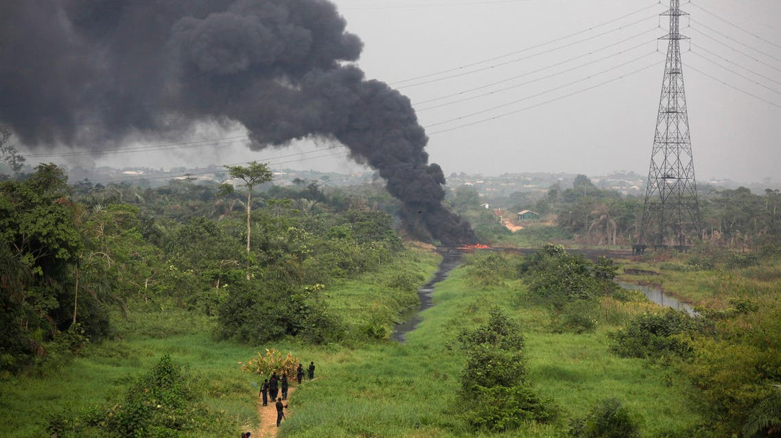 Nigerian civil defense corps officials secure the area following an explosion at a gasoline pipeline at Arepo, in Ogun, Nigeria, Wednesday, Jan. 23, 2013.