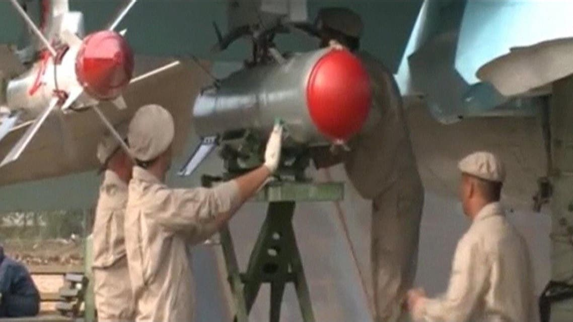 A frame grab taken from footage released by Russia's Defence Ministry November 30, 2015, shows Russian military engineers working on an Su-34 fighter bomber at Hmeymim airbase in Syria. Russian Su-34 fighter bombers flew in Syria for the first time with air-to-air missiles for self-defence on Monday, a Russian air force official told Russian news agencies, less than a week after a Turkish F-16 shot down a Russian jet. Footage released November 30, 2015. REUTERS/Ministry of Defence of the Russian Federation/Handout via Reuters ATTENTION EDITORS - THIS IMAGE WAS PROVIDED BY A THIRD PARTY. REUTERS IS UNABLE TO INDEPENDENTLY VERIFY THE AUTHENTICITY, CONTENT, LOCATION OR DATE OF THIS IMAGE. IT IS DISTRIBUTED EXACTLY AS RECEIVED BY REUTERS, AS A SERVICE TO CLIENTS. FOR EDITORIAL USE ONLY. NOT FOR SALE FOR MARKETING OR ADVERTISING CAMPAIGNS. IT IS DISTRIBUTED, EXACTLY AS RECEIVED BY REUTERS, AS A SERVICE TO CLIENTS. NO RESALES. NO ARCHIVE. TPX IMAGES OF THE DAY