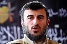 Top Syrian rebel leader killed in air strike in Damascus suburb - rebel sources =============================================                 BEIRUT, Dec 25 (Reuters) - Zahran Aloush, the head of Jaysh  al Islam, one of the most powerful insurgent groups in the  rebel-held suburbs of Damascus, was killed in an aerial raid  that targeted his group's headquarters, two rebel sources said  on Friday.                They said a secret headquarters of the rebel group, which is  the largest rebel faction in the area and has thousands of  fighters, was targeted by what they described as Russian planes.