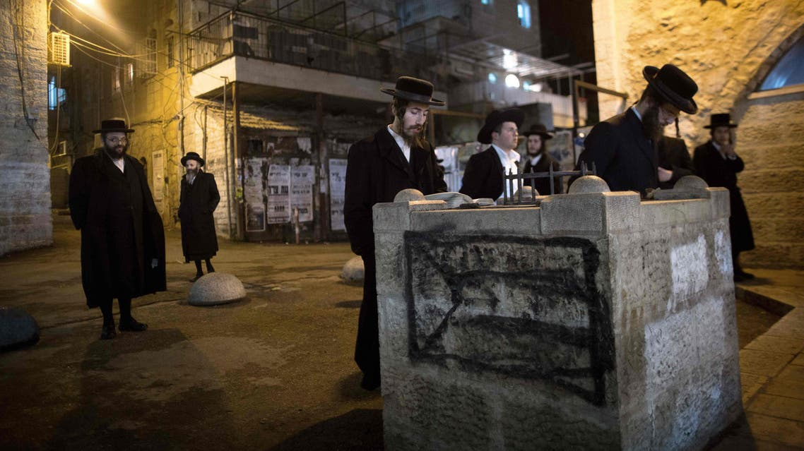 Anti-Zionist Ultra-Orthodox Jewish men pray to protest against the military service on December 11, 2015 in Jerusalem's ultra-Orthodox Mea Shearim neighbourhood