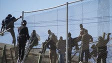 More than 200 migrants cross from Morocco into Spain's Melilla