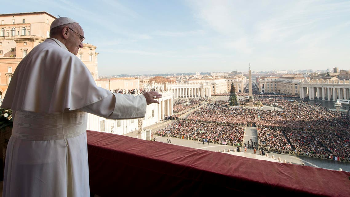 """Pope Francis delivers his """"Urbi et Orbi"""" (to the city and to the world) blessing from the central balcony of St. Peter's Basilica at the Vatican, Friday, Dec. 25, 2015."""