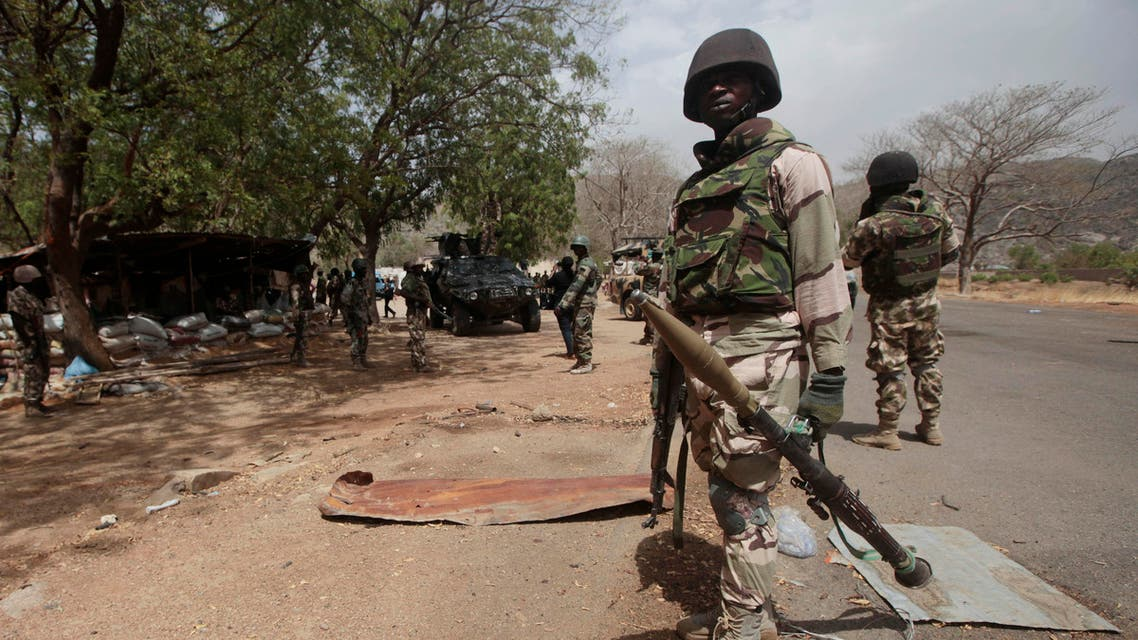 In this file photo taken Wednesday, April 8, 2015, Nigerian soldiers man a checkpoint in Gwoza, Nigeria, a town newly liberated from Boko Haram. (AP)