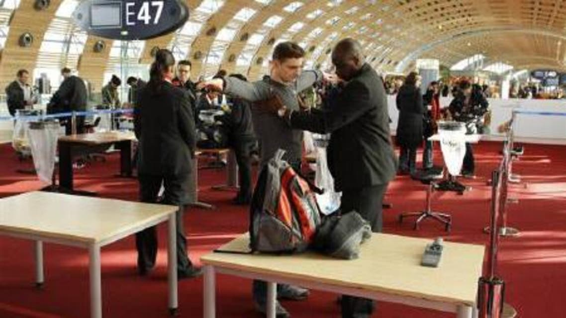 A security official checks a passenger at a departure gate at Roissy Charles-de-Gaulle airport near Paris February 22, 2010.  (Reuters)