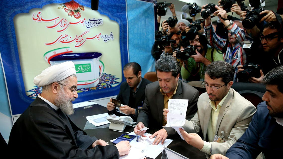 Iran's President Hassan Rouhani, who is also a member of the Experts Assembly, registers his candidacy for the Feb. 26 elections of the assembly at interior ministry in Tehran, Iran, Monday, Dec. 21, 2015. (AP Photo/Ebrahim Noroozi)