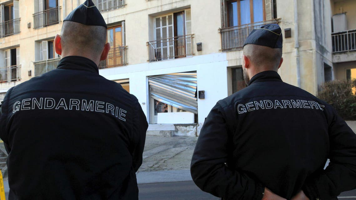 French policemen stand guard near a prayer hall on December 26, 2015 after demonstrators ransacked a Muslim prayer hall (AFP)