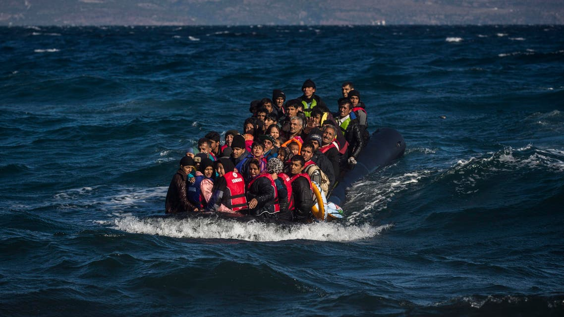 Afghan migrants on an overcrowded inflatable boat approach the Greek island of Lesbos in bad weather after crossing the Aegean see from Turkey, Wednesday, Oct. 28, 2015.
