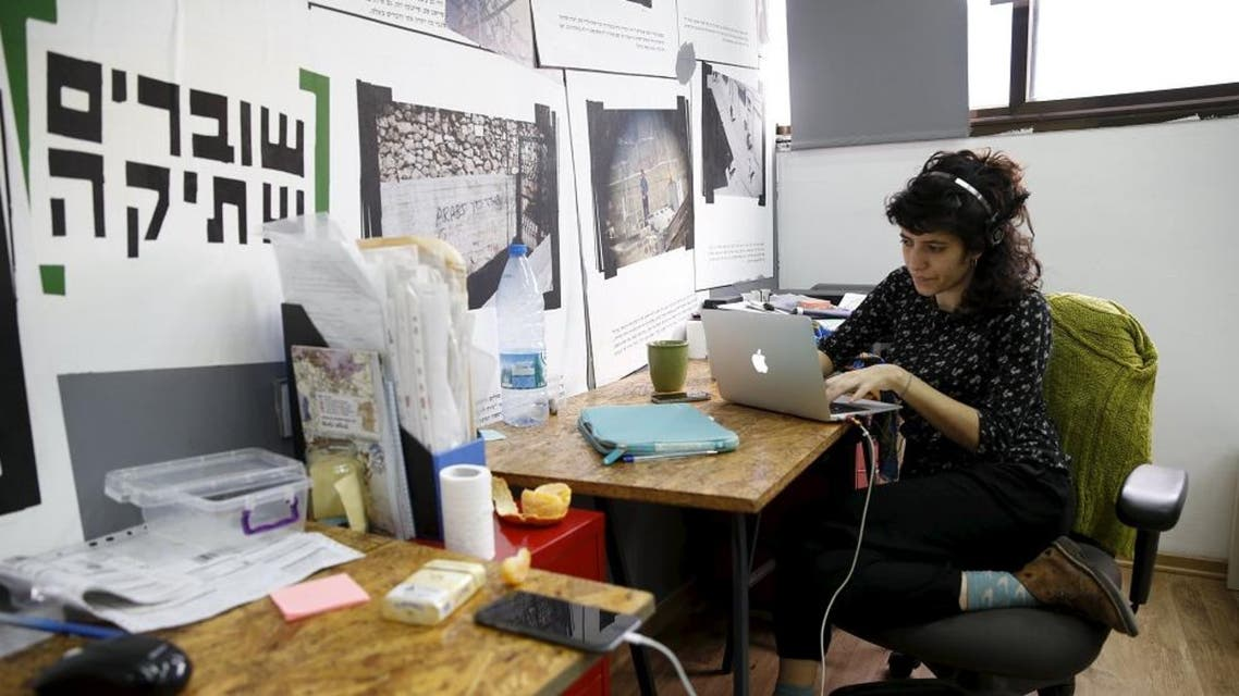 """An employee works at the offices of """"Breaking the Silence"""" in Tel Aviv, Israel. (File photo: Reuters)"""