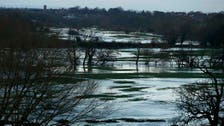Floods hit parts of England as government scrambles to respond