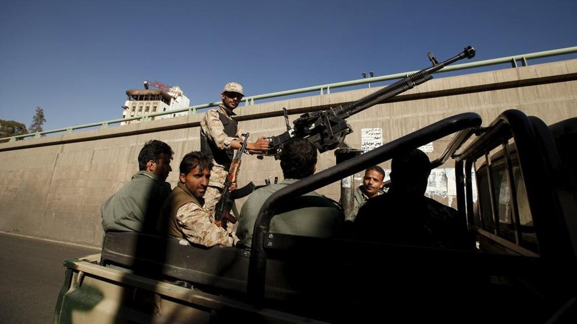 Houthi militants ride on the back of a patrol truck. (File photo: Reuters)