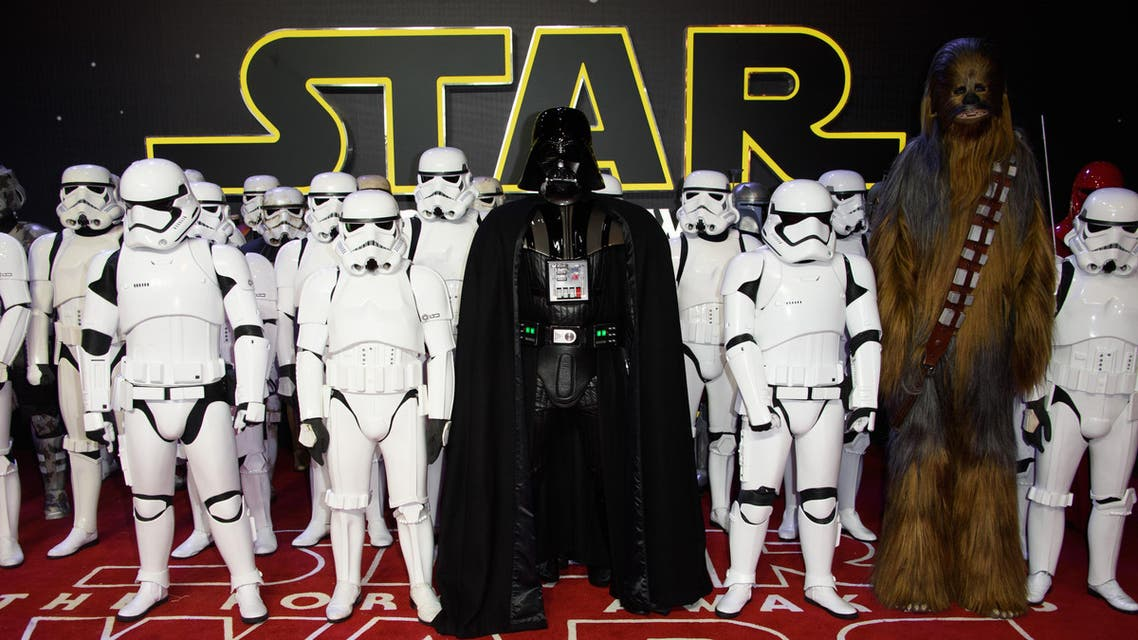 Actors dressed as Stormtroopers and Darth Vader pose for photographers upon arrival at the European premiere of the film 'Star Wars: The Force Awakens ' in London, Wednesday, Dec. 16, 2015.
