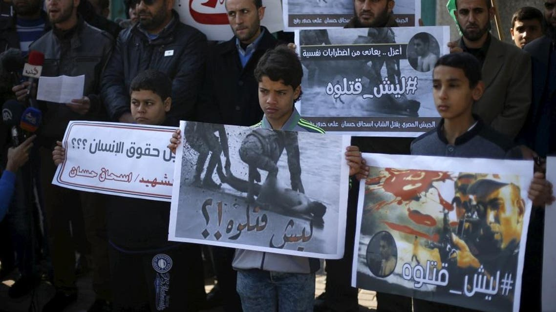 Palestinians take part in a protest to condemn what Gaza's interior ministry said was the killing of a mentally-ill Palestinian by Egyptian forces, after he waded across the sea into Egyptian territory, in Gaza City December 27, 2015. (Reuters)