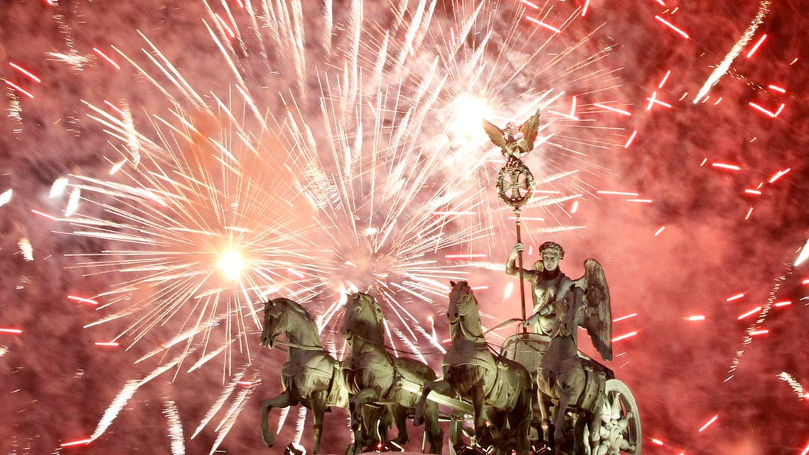 Fireworks illuminate the Quadriga sculpture atop the Brandenburg Gate during a New Year's Eve party in Berlin, January 1, 2011. (Reuters)