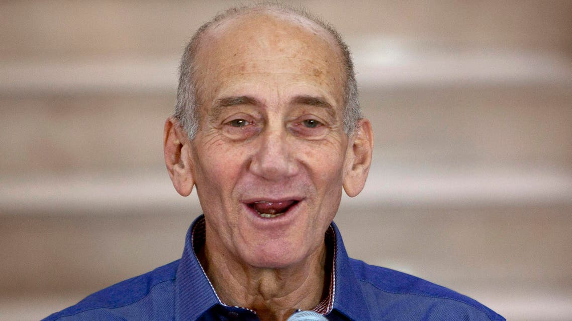 In this July 10, 2012 file photo, Former Israeli Prime Minister Ehud Olmert speaks to the media after hearing the verdict in his trial, in Jerusalem's District Court. (AP)