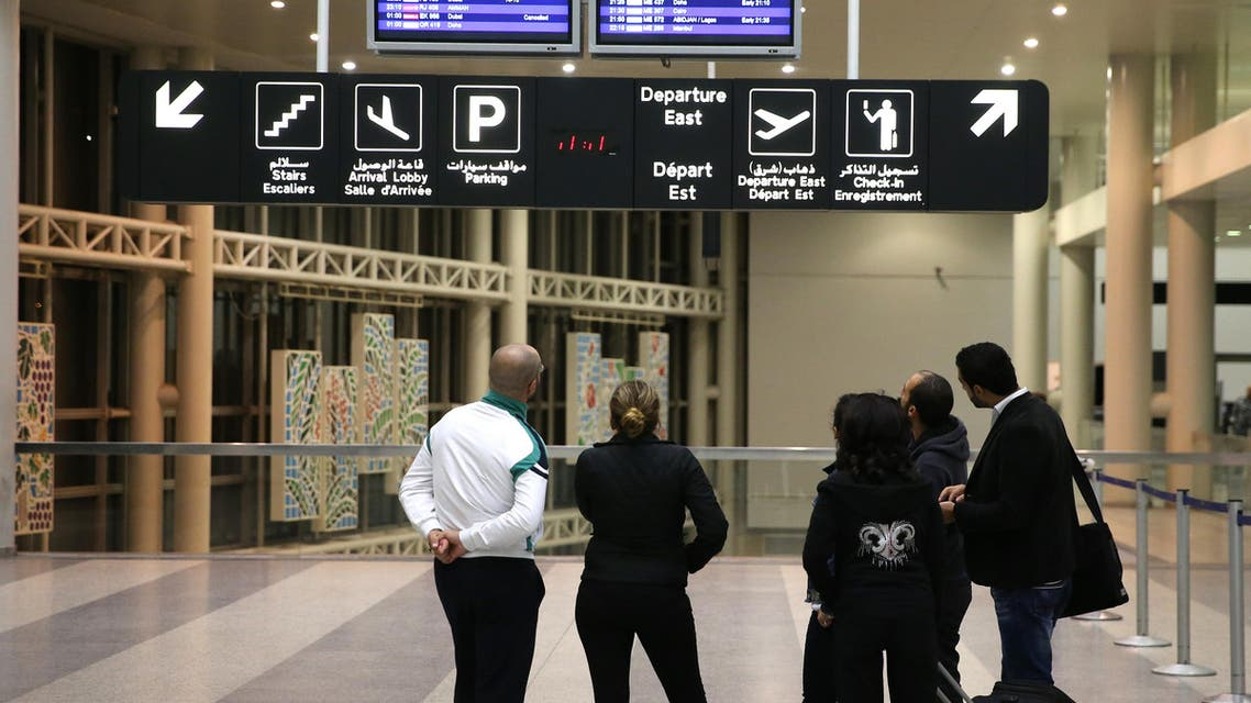 Travelers look at flights schedule screens as they check any delayed or canceled flights, at the departure terminal of Rafik Hariri international airport, in Beirut, Lebanon, Friday, Nov. 20, 2015. (AP)