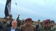 Iraq's Abadi plants flag in Ramadi to mark ISIS defeat