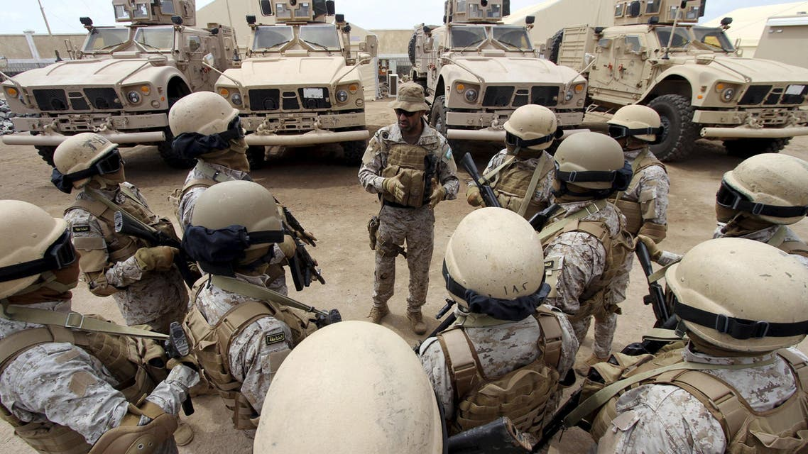 Senior army commander Abdullah al-Sahian (C), who commands the Saudi forces in Yemen's southern port city of Aden, talks to his soldiers in their base in Aden, in this September 28, 2015 file photo.  (Reuters)