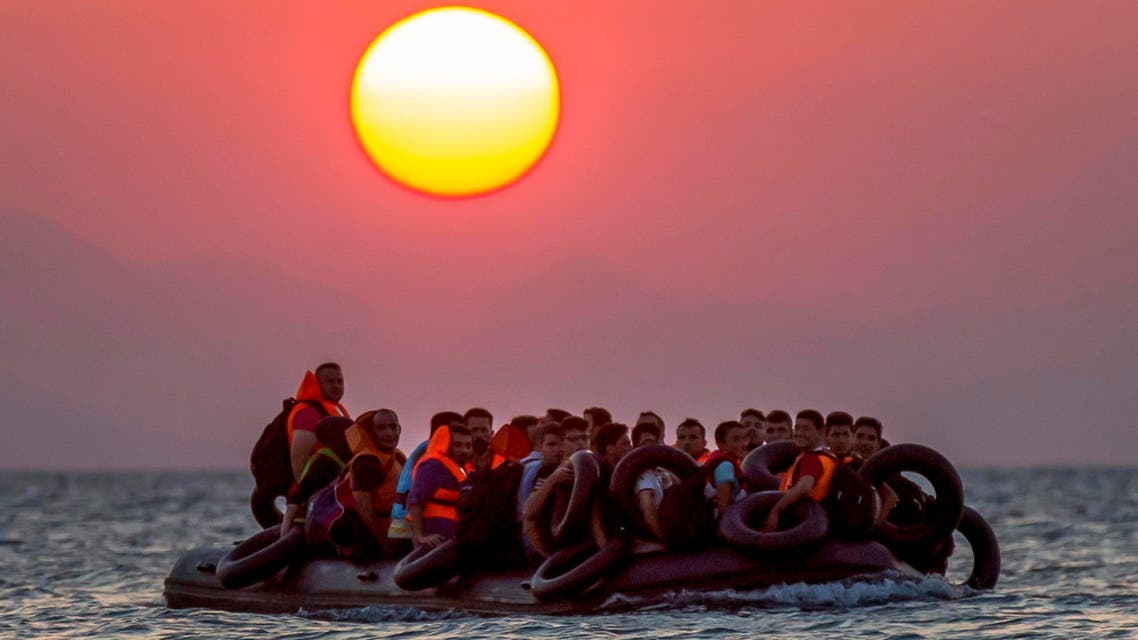 Migrants on a dinghy arrives at the southeastern island of Kos, Greece, after crossing from Turkey, Thursday, Aug. 13, 2015. (AP)