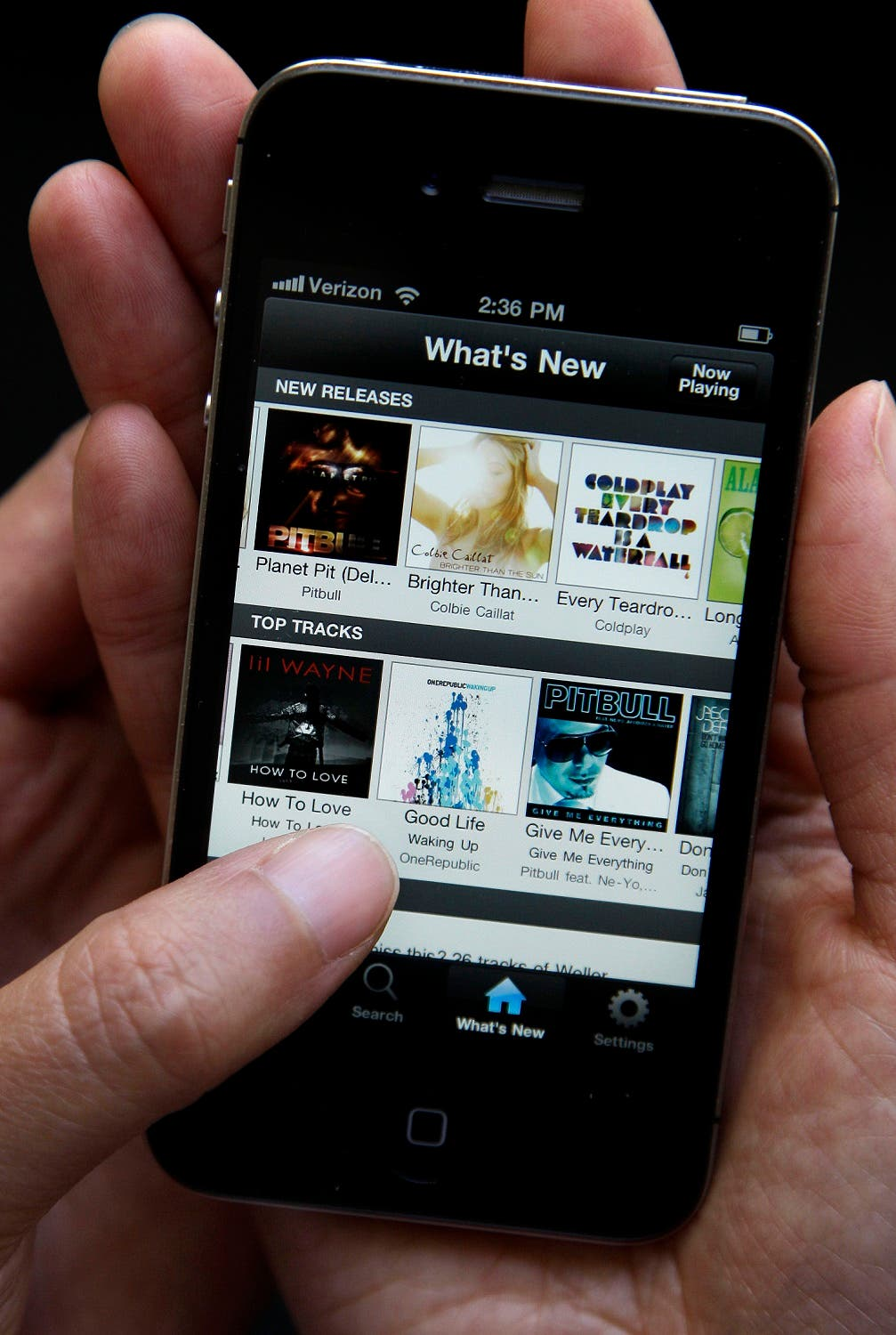 An Associated Press reporter demonstrates Spotify during a product review in San Francisco. (AP)