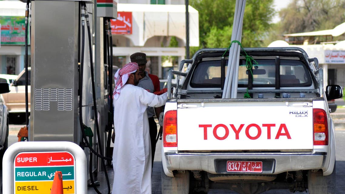 A motorist pumps petrol at a petrol station in Al Buraimi, near Oman's border with the United Arab Emirates September 14, 2010 (Reuters)