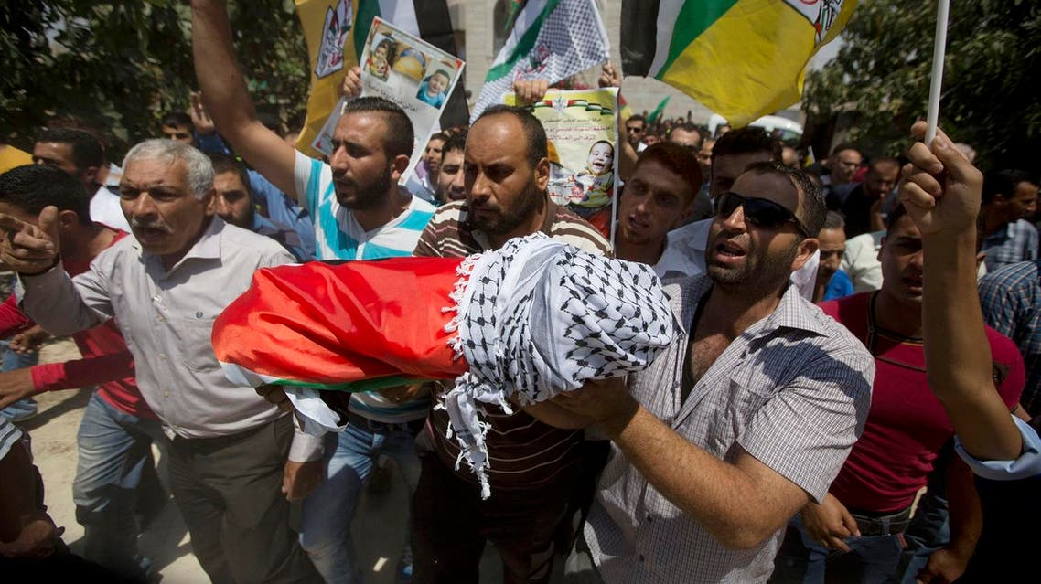 Palestinians carry the body of one-and-a-half year old boy, Ali Dawabsheh, during his funeral in Duma village near the West Bank city of Nablus. (File photo: AP)