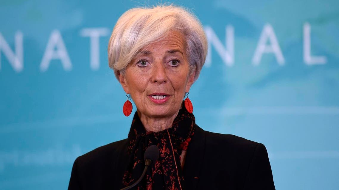 IMF Managing Director Christine Lagarde warned that rising U.S. interest rates and a stronger dollar could lead to firms defaulting on their payments. (AP)