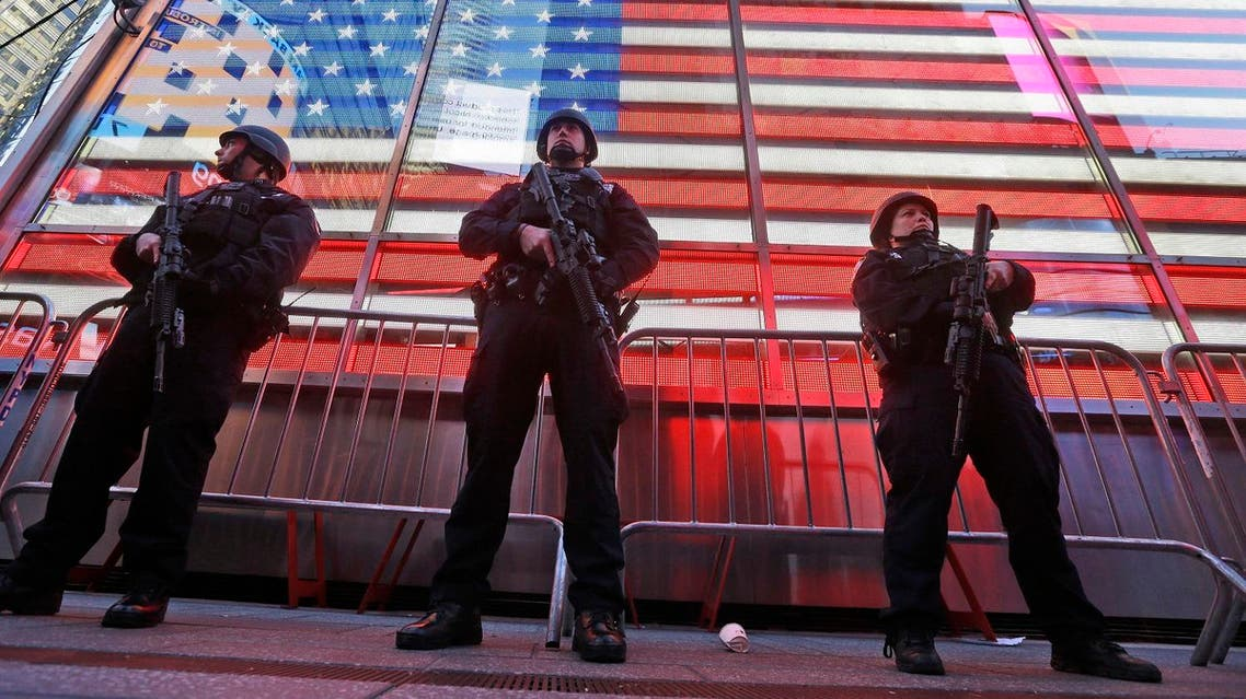 In this Nov. 14, 2015 file photo, heavily armed New York city police officers with the Strategic Response Group stand guard at the armed forces recruiting center in New York's Times Square. (AP)