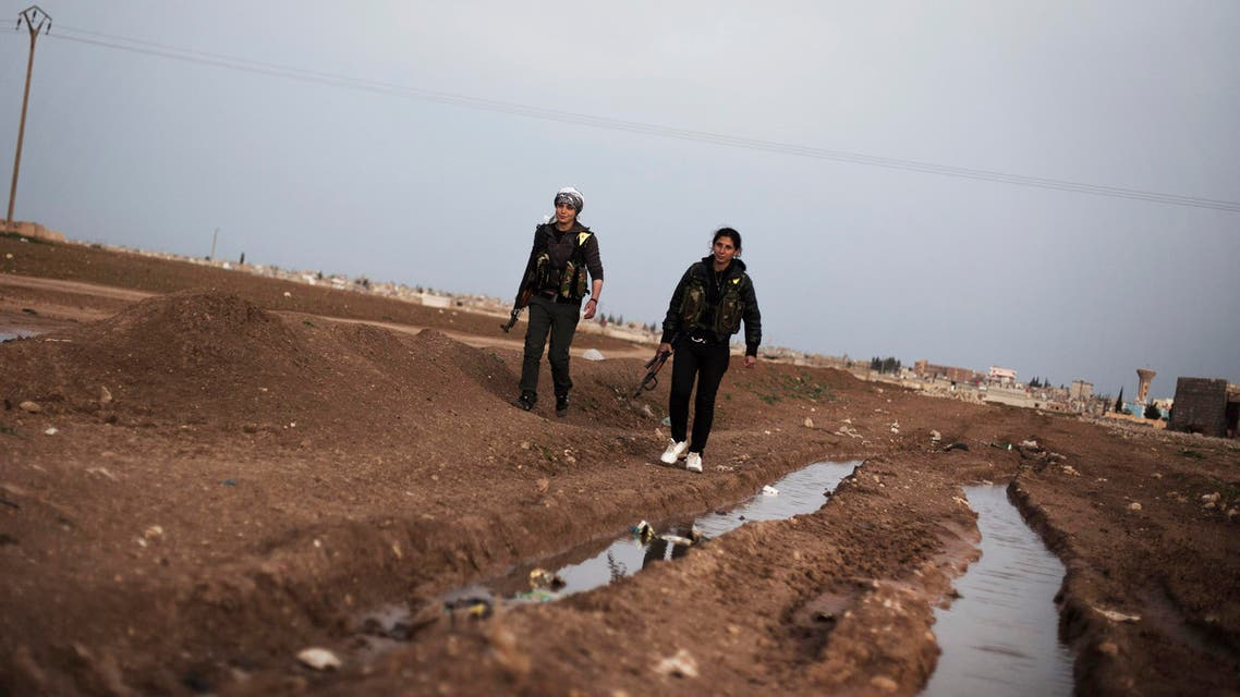 Kurdish female members of the Popular Protection Units gurad a check point near the northeastern city of Qamishli, Syria, Sunday, March 3, 2013. (AP)
