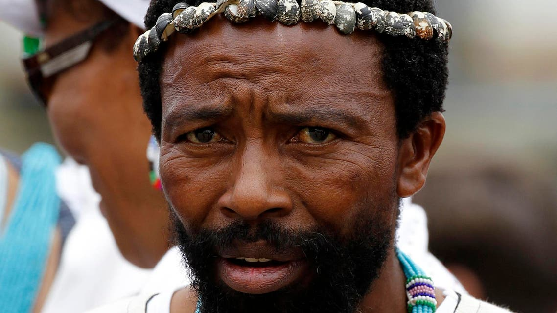 AbaThembu King Buyelekhaya Dalindyebo waits for the arrival of the former South African President Nelson Mandela's casket at the Mthatha airport in the Eastern Cape province of South Africa, December 14, 2013. (AP Photo/Siphiwe Sibeko, Pool)