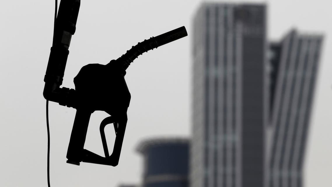 A gasoline pump is seen hanging at a petrol station in central Seoul in this April 6, 2011 file photo. REUTERS/