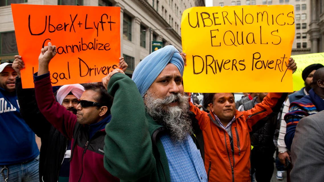 Taxi and Uber's black car service drivers protest the ride-hailing services Uber X and Lyft Wednesday, Dec. 16, 2015, in Philadelphia. (AP)
