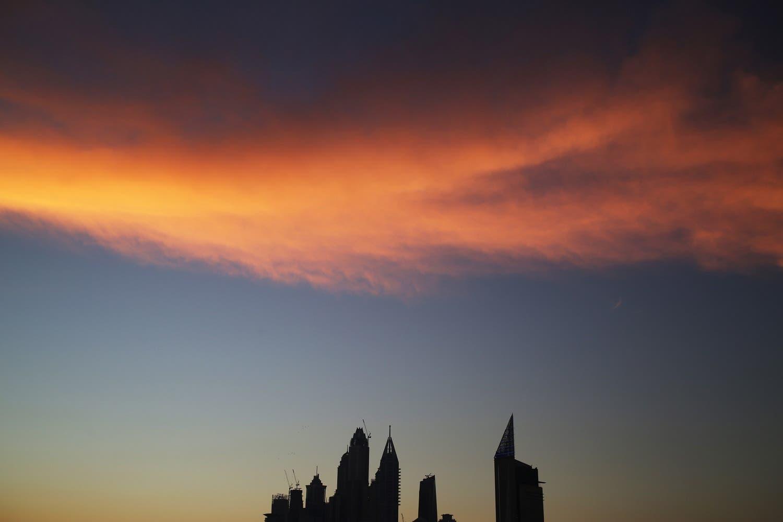 The setting sun sets wispy clouds aglow above the skyline of the Dubai Marina in Dubai. (AP)