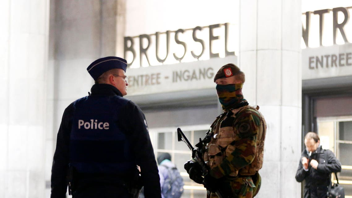 Belgium police officers talk to each other in front of the central station in downtown Brussels, Belgium, Monday, Nov. 23, 2015. The Belgian capital Brussels has entered its third day of lockdown, with schools and underground transport shut and more than 1,000 security personnel deployed across the country. (AP Photo/Michael Probst)