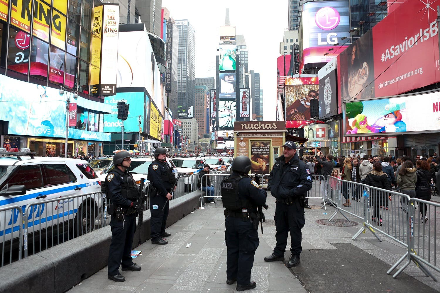 New York Police officers with rifles stand guard in Times Square in Manhattan. (Reuters)