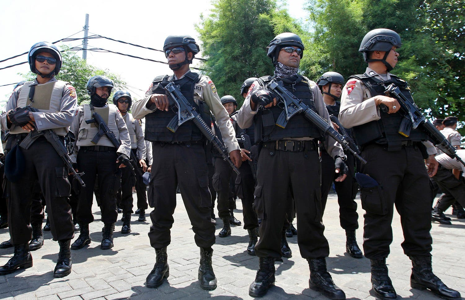 Police officers prepare to be deployed to secure New Year celebrations in Bali. (AP)