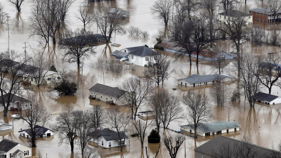 In this aerial photo, homes are surrounded by floodwater, Wednesday, Dec. 30, 2015, in Pacific, Mo. (AP)