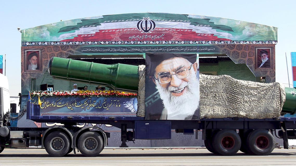 A military truck carrying a missile and a picture of Iran's Supreme Leader Ayatollah Ali Khamenei is seen during a parade marking the anniversary of the Iran-Iraq war (1980-88) in Tehran, in this September 22, 2015 file photo. President Barack Obama's administration is preparing new sanctions on international companies and individuals over Iran's ballistic missile programne, sources familiar with the situation said on December 30, 2015. REUTERS/Raheb Homavandi/TIMA/FilesATTENTION EDITORS - THIS PICTURE WAS PROVIDED BY A THIRD PARTY. REUTERS IS UNABLE TO INDEPENDENTLY VERIFY THE AUTHENTICITY, CONTENT, LOCATION OR DATE OF THIS IMAGE. FOR EDITORIAL USE ONLY. NOT FOR SALE FOR MARKETING OR ADVERTISING CAMPAIGNS. NO THIRD PARTY SALES. NOT FOR USE BY REUTERS THIRD PARTY DISTRIBUTORS. THIS PICTURE IS DISTRIBUTED EXACTLY AS RECEIVED BY REUTERS, AS A SERVICE TO CLIENTS