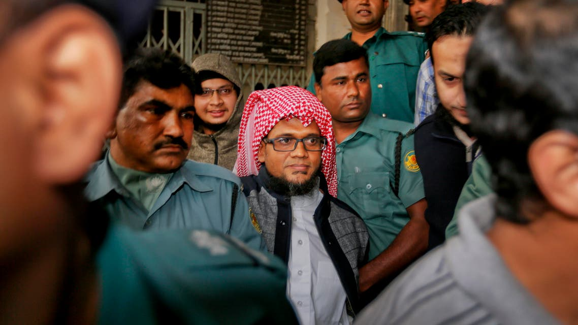 Bangladeshi policemen in olive green uniforms, escort defendants, in civil dress, from a court after a verdict in Dhaka, Bangladesh, Thursday, Dec. 31, 2015. (AP)
