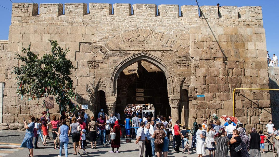 A file picture taken on September 19, 2015 shows people walking in front of the Naryn-Kala Fortress in Derbent. (AFP)