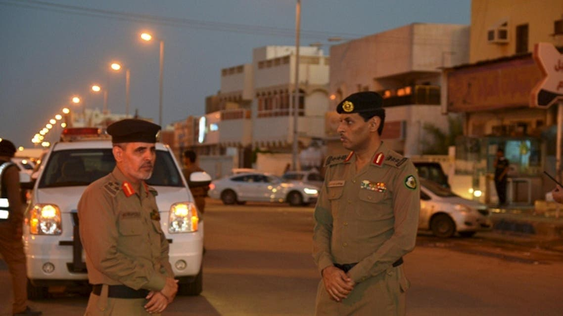 Members of Saudi security forces stand guard at Jazan General Hospital following a pre-dawn fire in the port city of Jazan, REUTERS